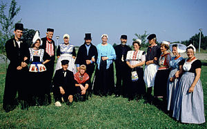Volendam - Dutch traditional costumes displayed at a folklife festival. The Volendam costumes are the first two on the left.
