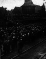 Crowd at Ann Arbor train station sending off football team, 1914.png