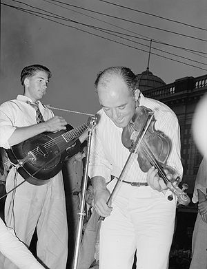 International Rice Festival - Cajun fiddler at 1938 National Rice Festival, photographed by Russell Lee.