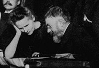 Marie Curie and Poincaré talk at the 1911 Solvay Conference.