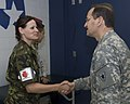 Czech Republic Medical Team member 1st Lt. Suataua Matulkova shakes hands with Texas State Guard Medical Brigade Commander Brigadier General Louis Fernandez.jpg