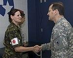 Czech Republic Medical Team member 1st Lt. Suataua Matulkova shakes hands with Texas State Guard Medical Brigade Commander Brigadier General Louis Fernandez.jpg