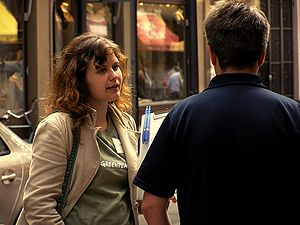 Greenpeace - Greenpeace street fundraiser talking to a passer-by.