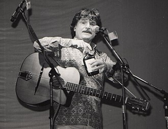 "Diz Disley - Diz Disley at the 1981 Essex Festival in his ""folk entertainer"" persona: ""Just one drink to steady myself..."""