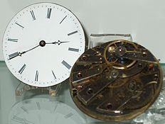 approx. 02:39 (or 02:39) displayed on clock/watch
