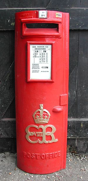 Pillar box - This rare Edward VIII pillar box door shows the built-in posting aperture, collection plate and the Royal cypher at Colne valley Postal History Museum, Halstead, Essex