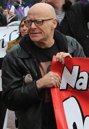 Eamonn McCann - Eamonn McCann (centre), on a march against austerity in Belfast, October 2012