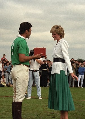 Diana, Princess of Wales - Diana presents Guillermo Gracida, Jr. a trophy at Guards Polo Club in 1986