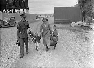 Spike Island, County Cork - A member of the British Army (with family) departing following the cession of Spike Island (July 1938)
