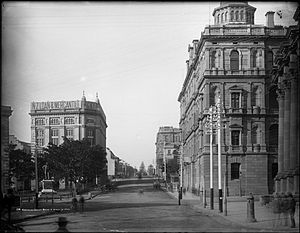 Bridge Street, Sydney - Exchange Corner (the location of the Sydney Stock Exchange) on Bridge Street, with Department of Lands building on the right and Macquarie Place on the left, ca. 1900