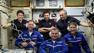Expedition 59 crew members Anne McClain, Oleg Kononenko, and David Saint-Jacques welcome their new crew members, Nick Hague, Alexey Ovchinin, and Koch (bottom right) who arrived at the International Space Station on March 14, 2019. Expedition 59 welcoming ceremony.jpg