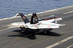 F-18E of VFA-147 lands on USS Nimitz (CVN-68) in 2013.jpg