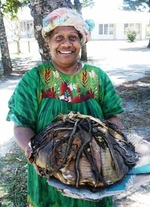 Kanak people - A Kanak woman with bougna, a casserole of fruit and fish baked in a ground oven.