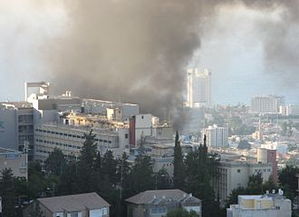 2006 Lebanon War - Smoke over Haifa, Israel, after a rocket launched by Hezbollah hit the city near Bnei-Zion hospital