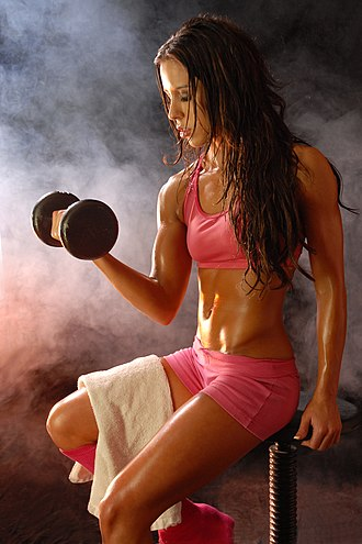 Fitness fashion - A model poses wearing sportswear that is revealing and aderent.