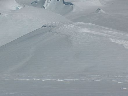 Zemen Knoll from Miziya Peak, with Radnevo Peak and Leslie Hill in the background. Footprints in snow on Zemen Knoll, South Shetland Islands.jpg