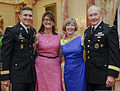 From left, U.S. Army Gen. Michael T. Flynn, the director of the Defense Intelligence Agency, and his wife, Lori, pose for a photo with Deanie Dempsey and Chairman of the Joint Chiefs of Staff Army Gen. Martin E 130611-D-HU462-390.jpg