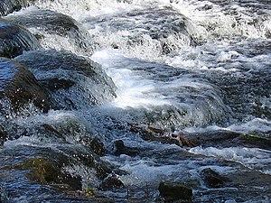 Water splashing over rocks.