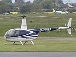 G-CHAP Robinson Raven R44 Helicopter (27044444966).jpg