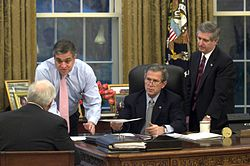 George Tenet gives a briefing to George W. Bush