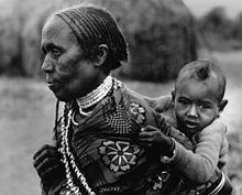 Grandmother carrying child in Borana, Ethiopia.jpg