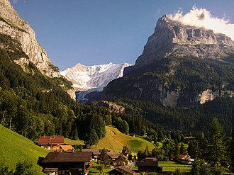 Grindelwald - View to southeast to the disappearing Lower Grindelwald Glacier with parts of the Mättenberg to the left, the Hörnli (2710 m a.s.l.) to the right, and the Fiescherhorn (4049 m a.s.l.) in the back