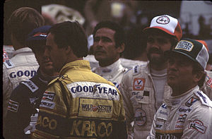 Roberto Guerrero - Guerrero (left) with (left to right) Geoff Brabham, Danny Ongais, Chet Fillip and Gary Bettenhausen at the 1984 Domino's Pizza 500 at Pocono International Raceway.