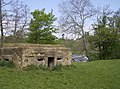 Gun emplacement and weir on River Frome - geograph.org.uk - 439013.jpg