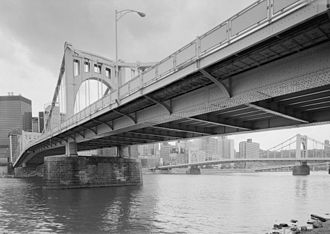 Three Sisters (Pittsburgh) - From north bank of the Allegheny, looking SW, downtown Pittsburgh in background, Sixth Street Bridge at right. Shows main plate girder (bearing compressive forces) and sidewalk support