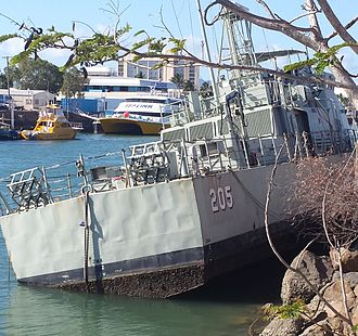 HMAS Townsville (FCPB 205) - Townsville resting on the bottom at low tide, at the Curtain Bros. wharf.