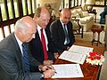 HMA Bob Dewar with Peter Upton (left) and Eamon Cassidy of DFID (right at the )Mission statement signing (3542201266).jpg