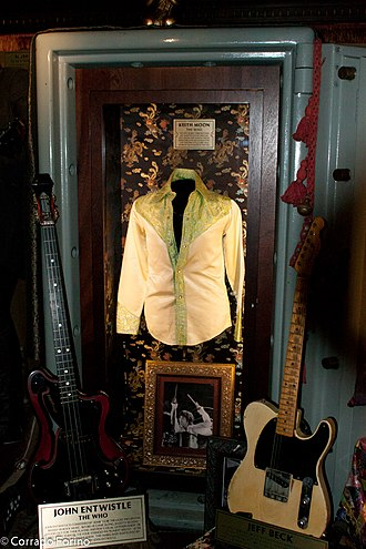 John Entwistle - Display of Entwistle's guitars and a shirt at the Hard Rock Cafe, London