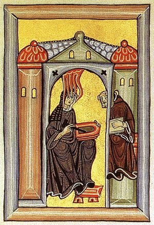 Revelation - Illumination from Liber Scivias, showing Hildegard of Bingen receiving a vision, dictating to her scribe and sketching on a wax tablet.