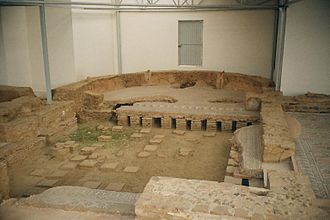 Exedra - The foundations and partial floor of a late Roman villa. The floored part is the exedra. The rest of the floor has deteriorated and is missing, with only parts of the hypocaust columns remaining. Hot air circulated through the hypocaust to heat the house.