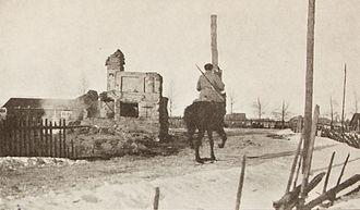 Battle of Länkipohja - A White cavalryman passing a ruined house