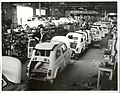 In foreground is Henry Jenaro Nelle, from Naples, an assembler at the Fiats Assembly Works.jpg