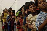 Iraqi Police Distribute School Supplies to children in Mosul, Iraq DVIDS181311.jpg