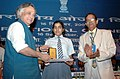 Jairam Ramesh presented Poster Competition Prize to a student, Ms. Sweta, at the inauguration of the International Ozone Day, in New Delhi on September 16, 2009.jpg