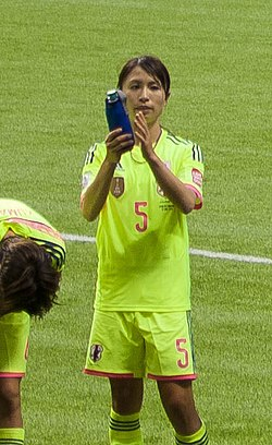 Japanese players salute FIFA Women's World Cup Canada June 12th, 2015 (18759926665) (cropped).jpg