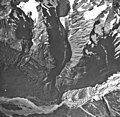 Jarvis Glacier, valley glacier mostly covered in rocks and mountain glaciers at the top of the image, September 17, 1966 (GLACIERS 5235).jpg