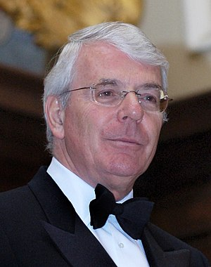 clean-shaven middle-aged white man with grey hair, wearing glasses