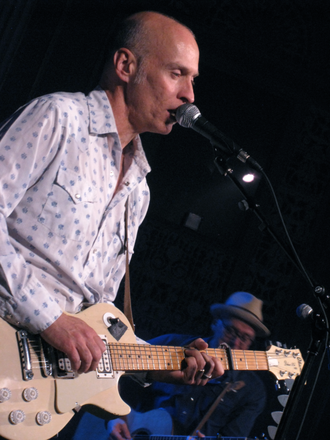 John Mann (musician) - Mann playing with Spirit of the West in 2010