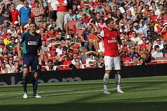 John O'Shea - O'Shea (left) in action for Sunderland against Arsenal in 2012