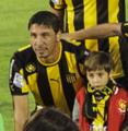 Juan Manuel Olivera con su hijo.png