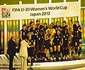 Julie Johnston receiving trophy at 2012 FIFA U-20 Women's World Cup.jpg