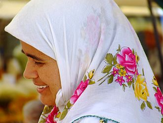 Intimate parts in Islam - A Turkish woman wearing a headscarf. Most Muslims hold that the face and the hands are excluded from  'awrah parts.