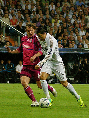 Kim Källström - Källström with Olympique Lyonnais against Cristiano Ronaldo and Real Madrid during their group stage match in the UEFA Champions League on 18 October 2011.