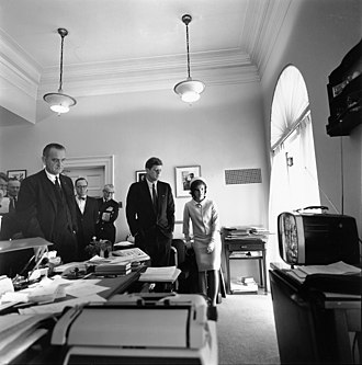 Timeline of the John F. Kennedy presidency - May 5: President Kennedy, Jackie Kennedy, and Vice President Johnson watch the launch of Freedom 7 from the office of his secretary, Evelyn Lincoln