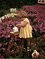 Kerry Arquette watering petunias at the Palmer Nurseries- Osprey, Florida (8866118295).jpg
