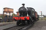 Kidderminster - 4566 arriving with freight train.JPG